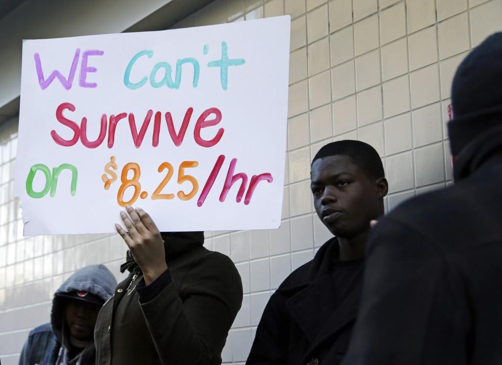 Protestors demonstrate outside of a McDonald's restaurant in Oakland, California, in December 2013.