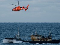 helicopter and ship in Pacific Ocean