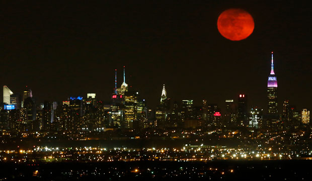 The moon rises in its waning period over the New York City skyline seen from West Orange, New Jersey, April 5, 2015.