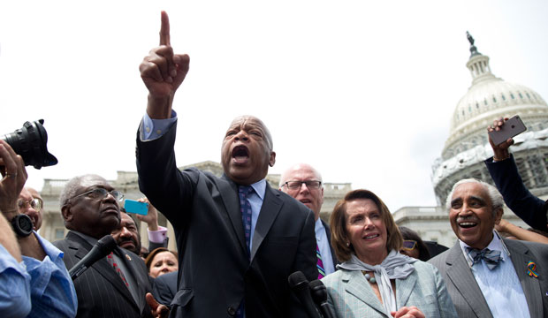 Rep. John Lewis (D-GA) speaks on Capitol Hill in Washington, D.C., on June 23, 2016, after House Democrats ended their sit-in protest on gun violence.