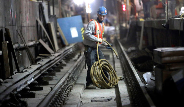 A contractor works on a construction project in New York, January 2013.
