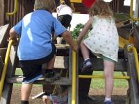 Children climb in a playground.
