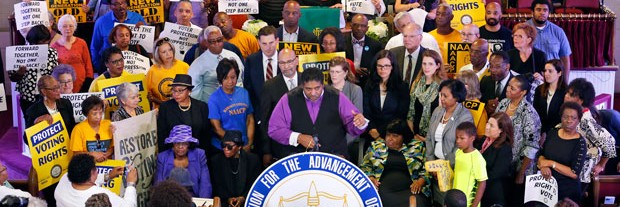 Rev. William Barber at a press conference