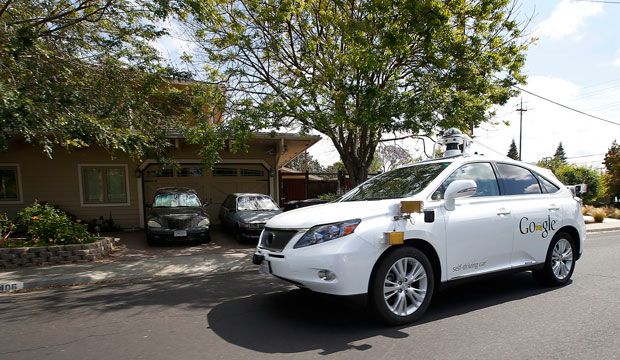 A self-driving car drives along a street during a demonstration in Mountain View, California, on May 13, 2015.