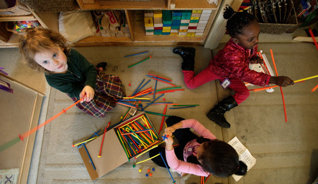 Preschool students build castles with building sticks at the Refugee and Immigrant Family Center in Seattle on April 5, 2012.