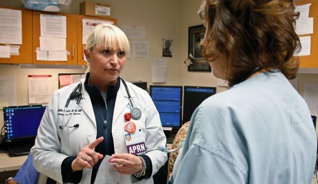 Jennifer Parrott, a certified nurse practitioner, talks with a doctor