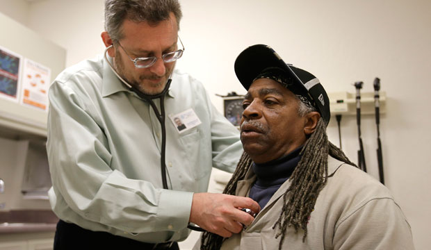 A doctor examines a patient at a clinic in Sacramento, California, on February 18, 2016.
