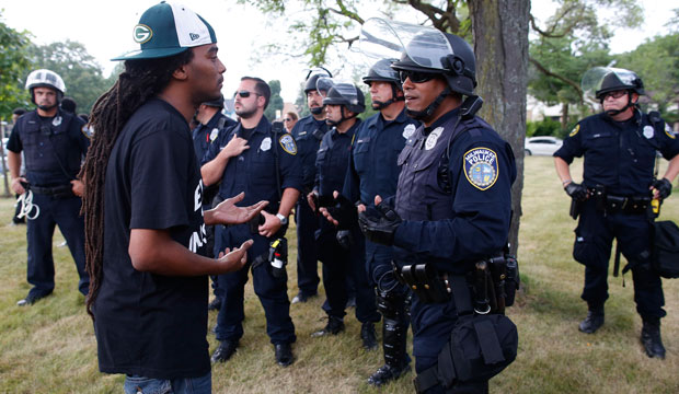 A man speaks with police in a park in Milwaukee, August 2016.