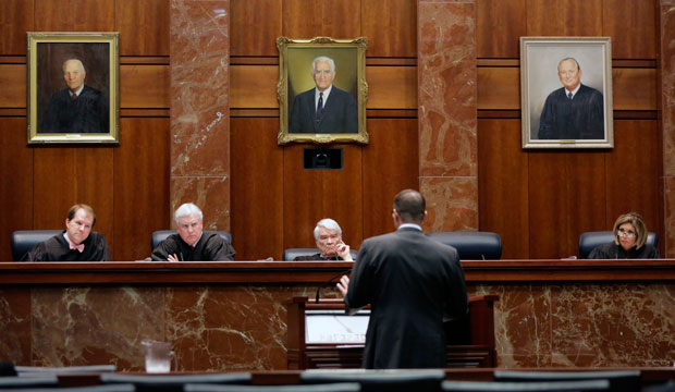 Texas Supreme Court justices listen as an attorney argues in a case, November 2015.