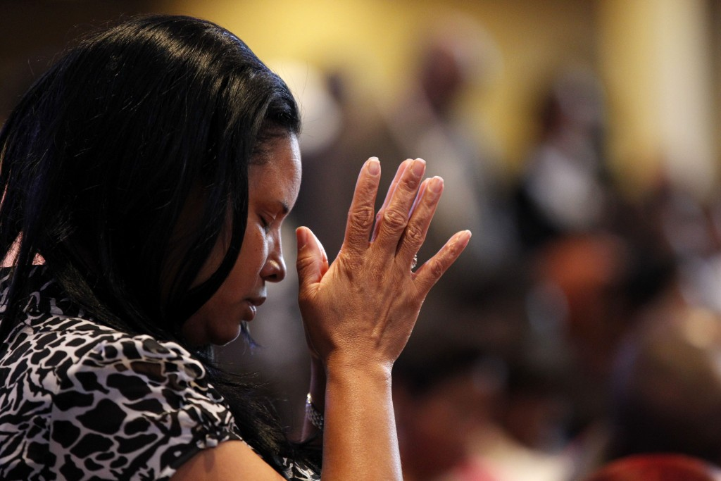 A congregation member prays at Franklin Avenue Baptist Church in New Orleans, June 3, 2012.