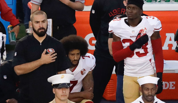 San Francisco 49ers quarterback Colin Kaepernick sits during the national anthem before an NFL preseason football game in San Diego, September 1, 2016.