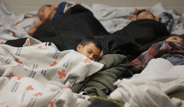 Children sleep in a holding cell at a U.S. Customs and Border Protection processing facility in Brownsville, Texas, on June 18, 2014.