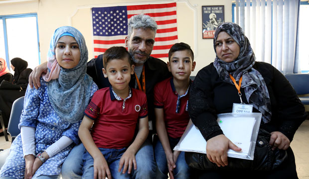 The Jouriyeh family, Syrian refugees headed to the United States, pose in Amman, Jordan, on August 28, 2016.