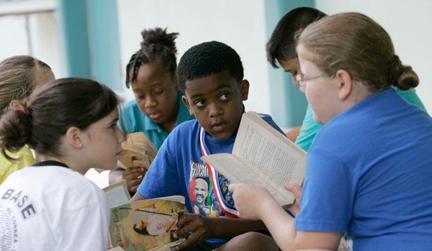 Students read outside of their classroom on June 4, 2009, in Homestead, Florida.