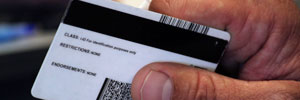 A person holds an identification card