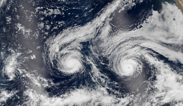 This satellite image released by NASA shows Hurricane Madeline and Hurricane Lester over the Pacific Ocean, August 2016.