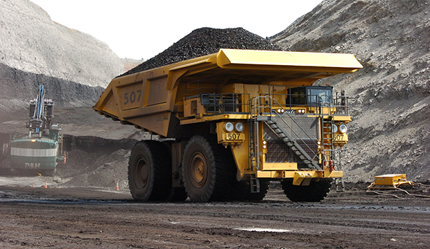 A mining dumper truck hauls coal at a strip mine near Decker, Montana, April 2013.