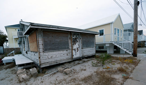 A boarded home damaged by Superstorm Sandy sits in the Breezy Point neighborhood of New York, on October 27, 2015.