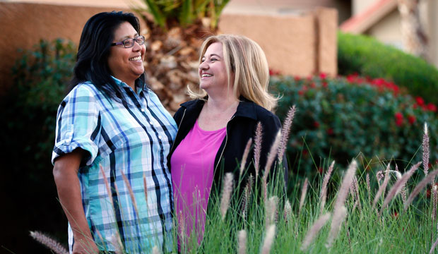 Cleo Pablo and her wife, Tara Roy-Pablo, stand outside their home in Phoenix, Arizona, on November 9, 2015.